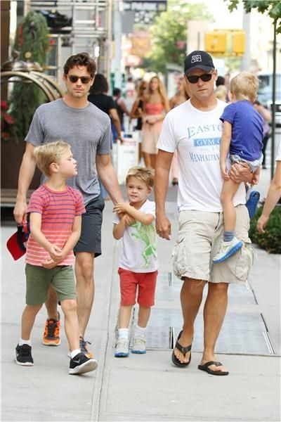 Simon Halls and Matt Bomer with children