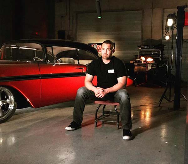 Street Outlaws' Ryan Martin sitting next to his car
