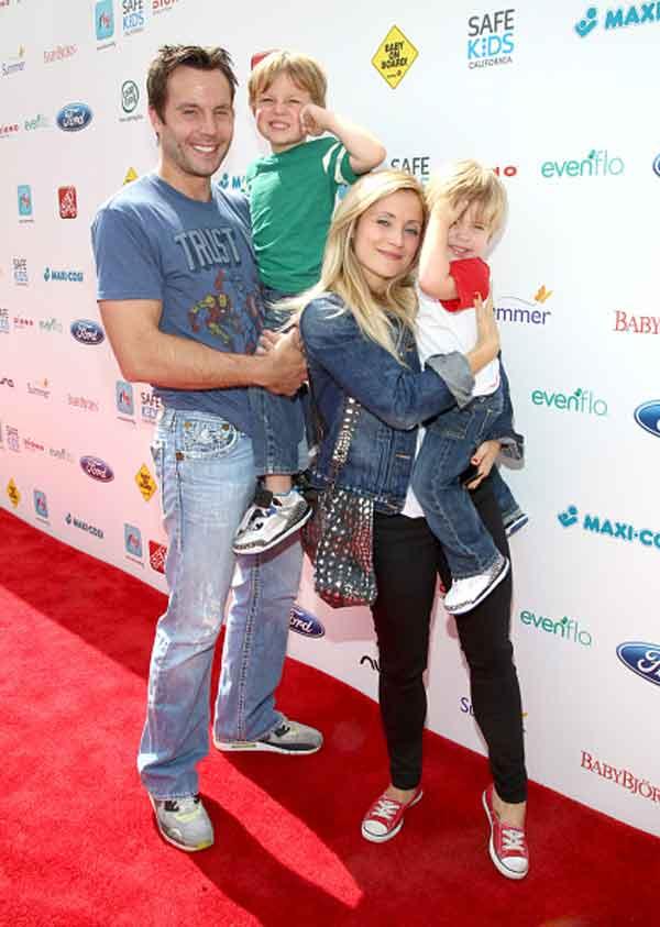 Image of Emmr Rylan with her husband and kids
