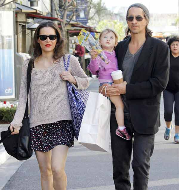 Image of Michael Easton with his wife and daughter