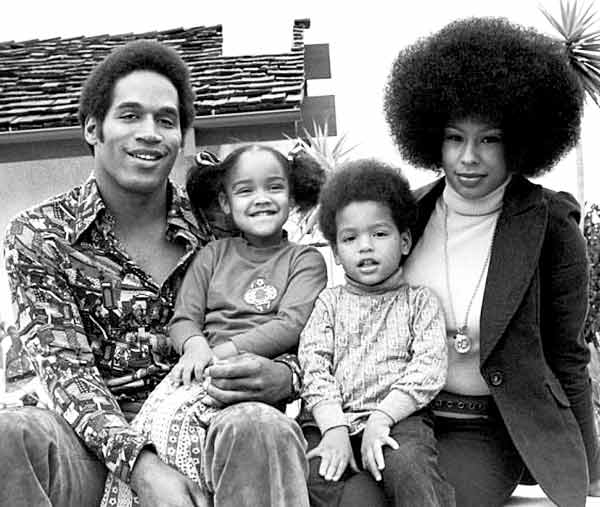 Image of Arnelle Simpson with her father, mother and her brother