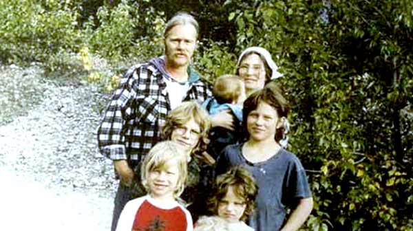 Image of Alaskan Bush People Cast Billy Brown with his wife and their children