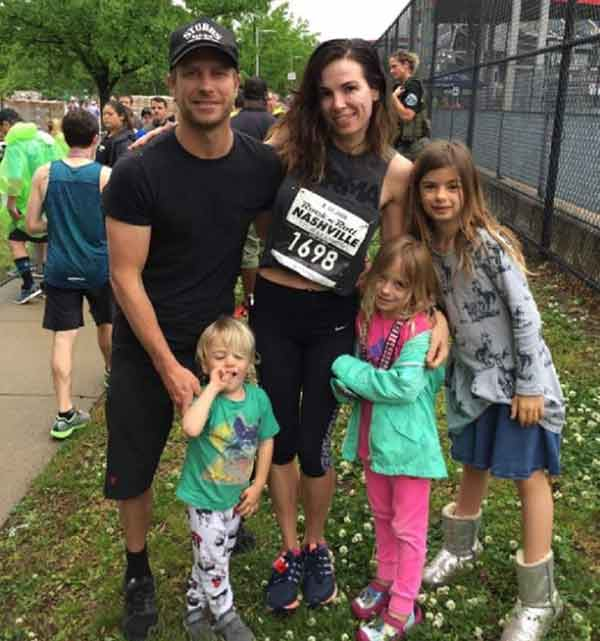 Image of Dierks Bentley with his wife and their kids