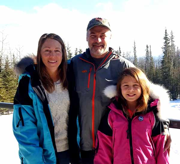 Image of Dr. Michelle Oakley with her husband Shane Oakley and her daughter