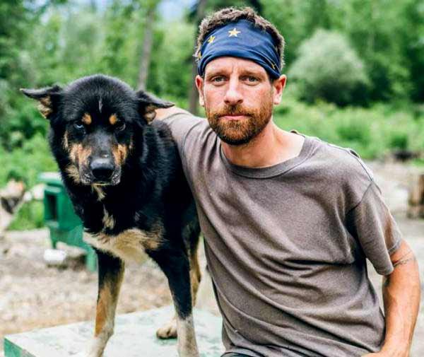 Image of Life Below Zero cast Jessie Holmes with his dog