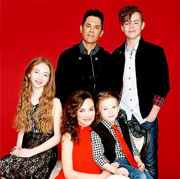 Image of Rebecca Herbst with her husband Michael Saucedo and their kids