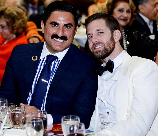 Image of Reza Farahan with his partner Adam Neely