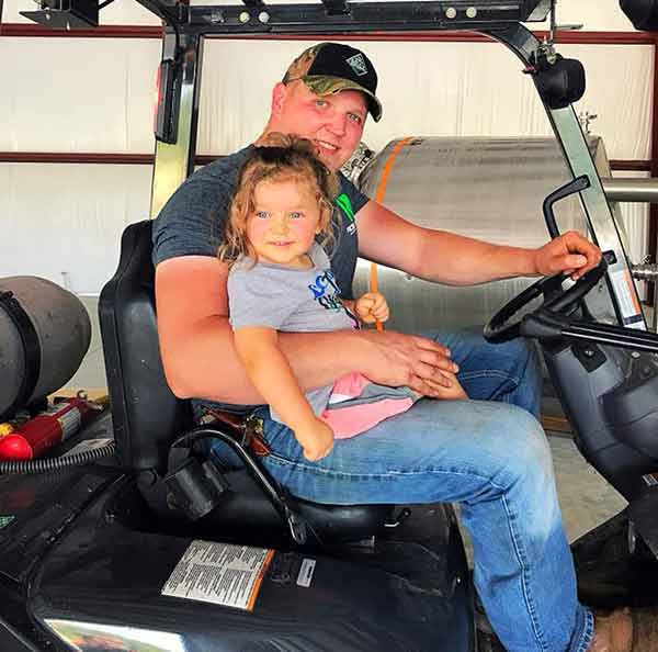 Image of Tyler Wood with his daughter Addison