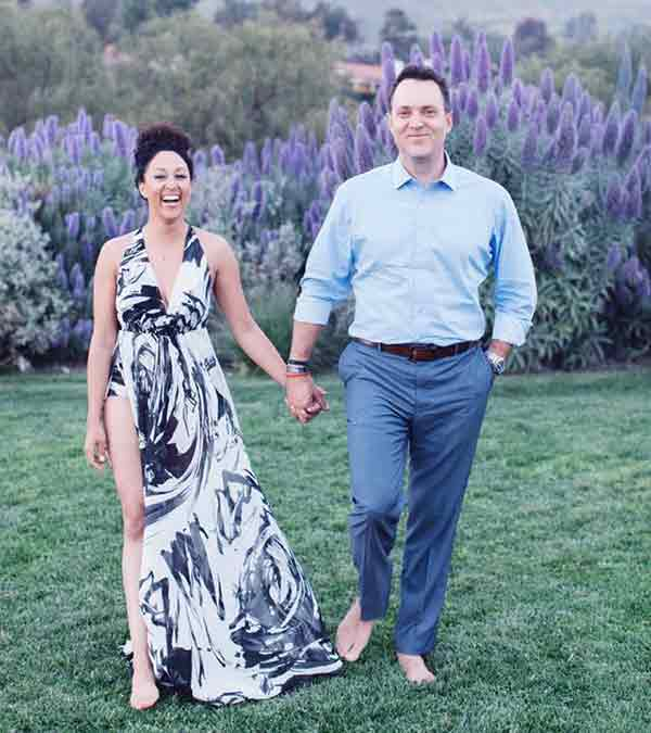 Image of Tamera Mowry with her husband Adam Housley