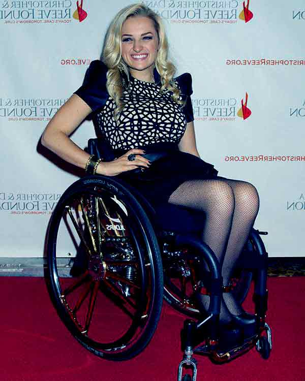 Image of Ali Storker use wheelchair due to car accident