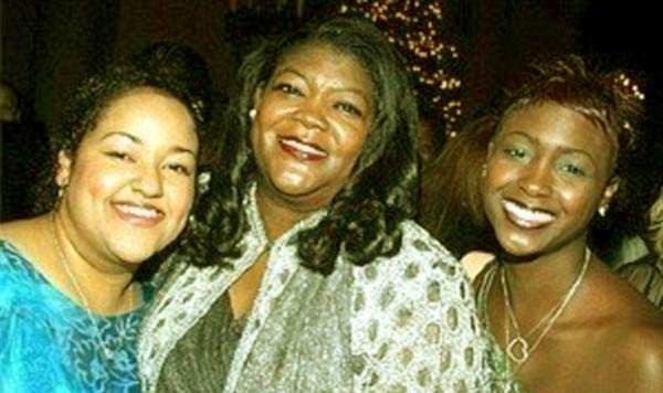 Image of Carolyn Dennis (centre) with her daughter Desiree (right) and Unidentified friend