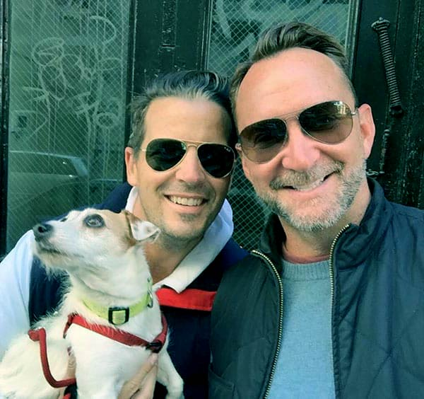 Image of Damon Bayle with his wife-husband Clinton Kelly and their dog, no children