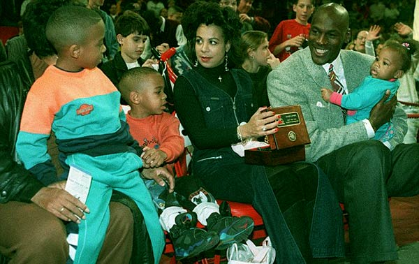 Image of Michael Jordan, (right), with his daughter Jasmine and his former wife Juanita with sons, Marcus and Jeffrey