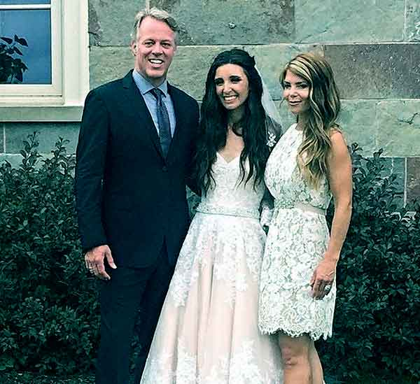 Image of Scott Yancey with his wife Amie Yancey and with their daughter