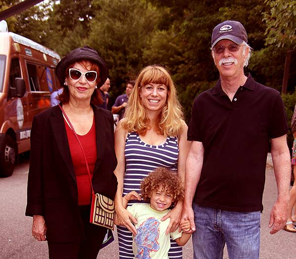 Image of Steve Janowitz with his wife Joy Behar (left) and with her daughter Eve Behar and grandson Luca