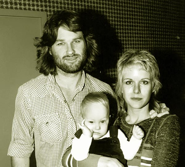Image of Young Boston Russell with his parents Kurt Russell (father)and Season Hubley (mother)