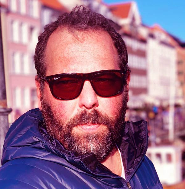 Image of wiki, bio, net worth and married life of Stand-up comedian, Bert Kreischer