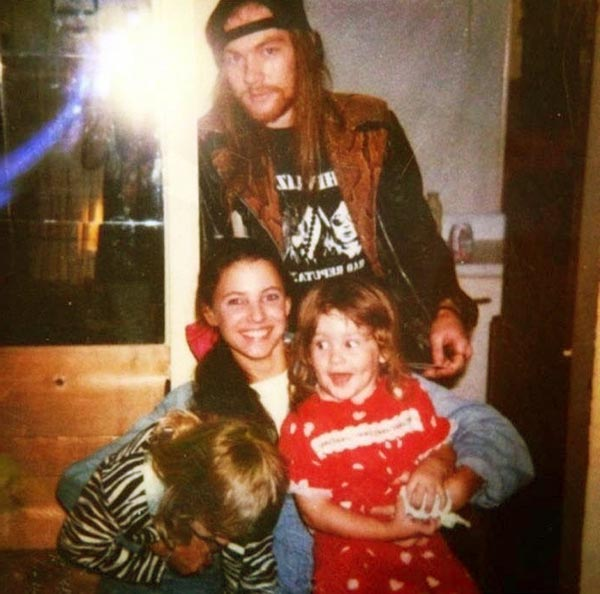 Image of Erin Everly with her ex-husband Axl Rose and with their kids