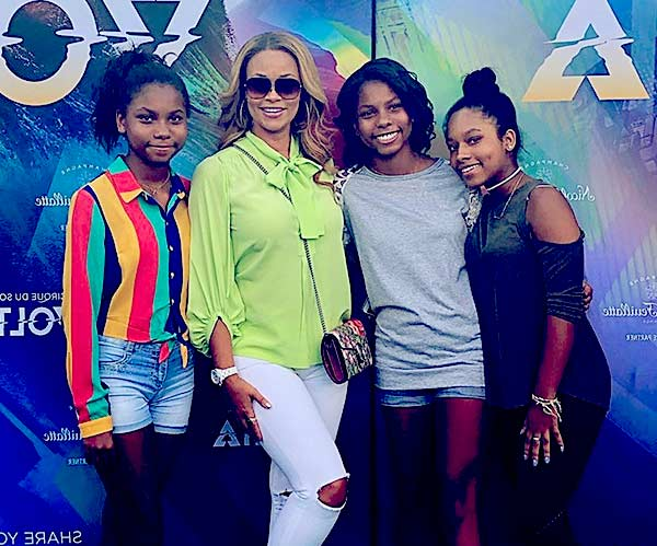 Image of Caption: Gizelle and Jamal with her daughters