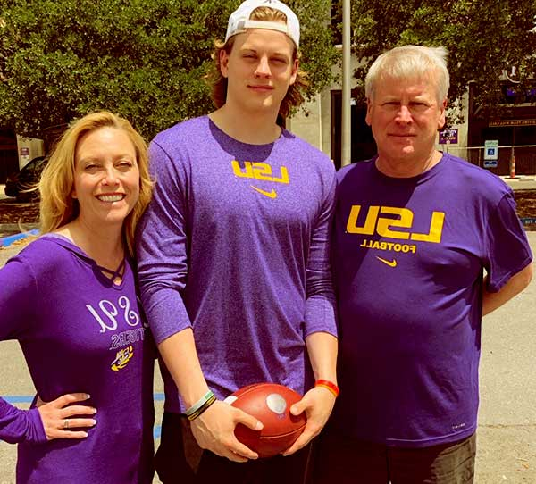 Image of Joe Burrow with his father (Jimmy Burrow) and mother (Robin Burrow)