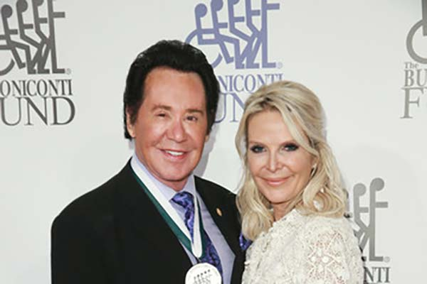 image of Kathleen McCrone along with his husband, Wayne Newton attending an event.