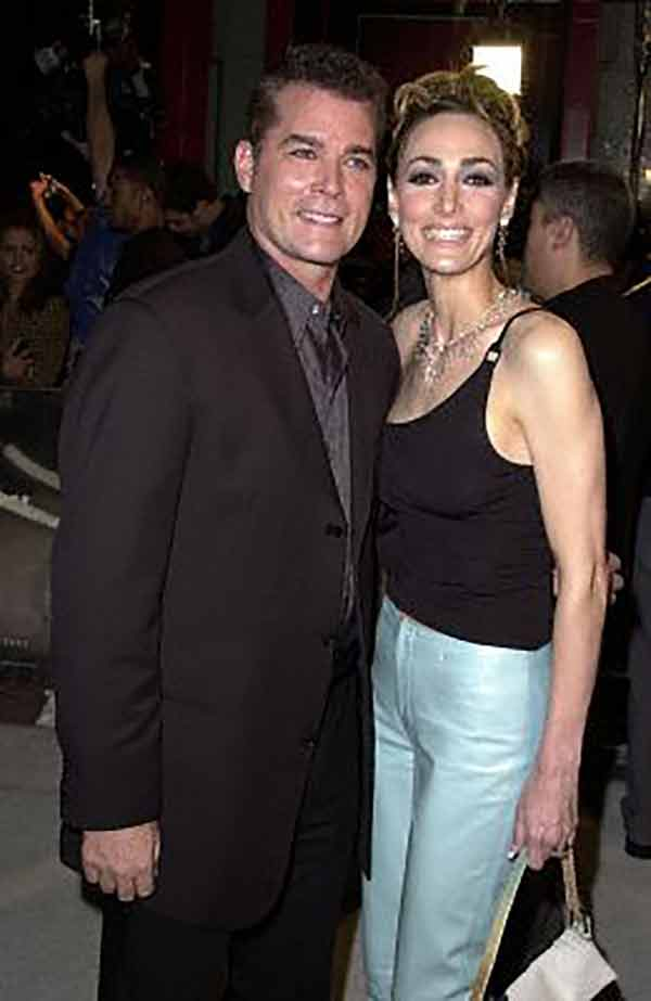 Picture Ray Liotta and Michelle Grace affectionately sharing a frame