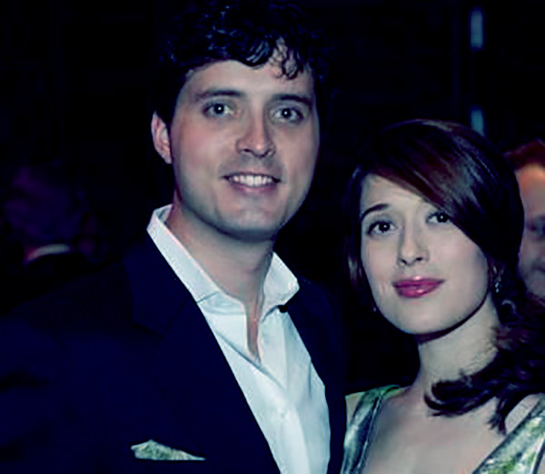 Image of Eli Kay Oliphant with his wife, Marina Squerciati.