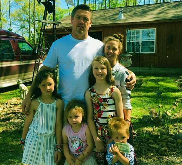 Image of Tricia, Her Husband Along With Three Lovely Daughters & A Dollar Hungry Son
