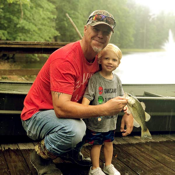 Image of Cutler is fishing with his father, Chipper Jones