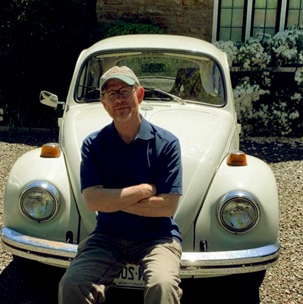 Image of Ron Howard with his car, VW Bug Car.