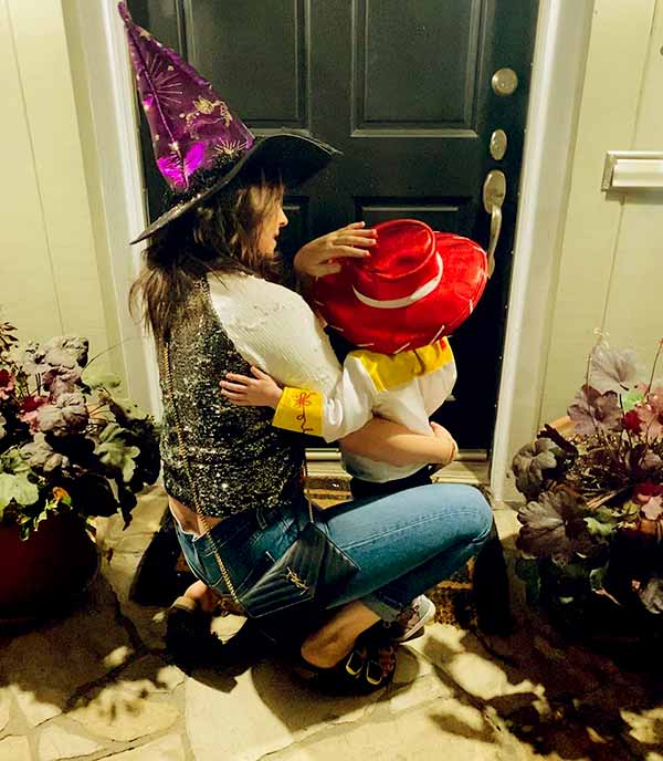 Image of Camilla celebrating Halloween with her daughter