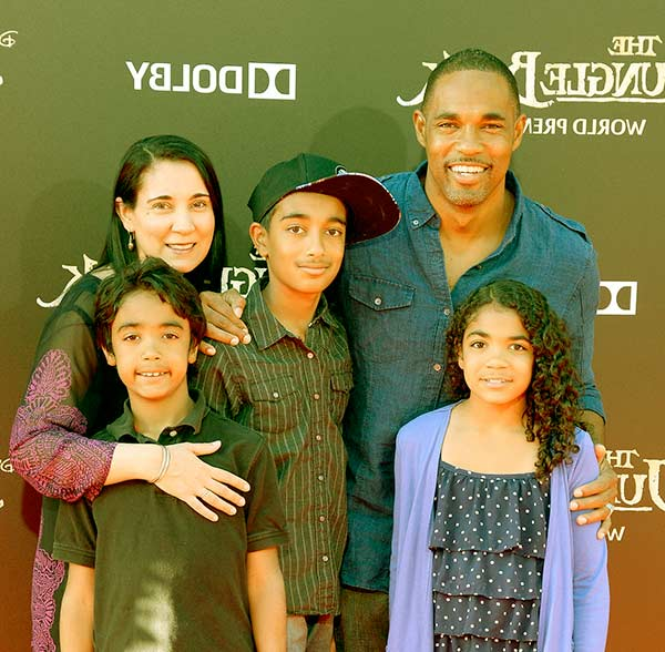 Image of Jason Winston George with his wife and kids
