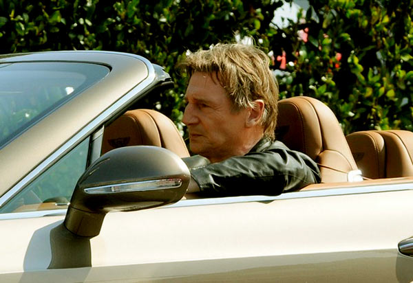Image of Liam Neeson in his Bentley car.