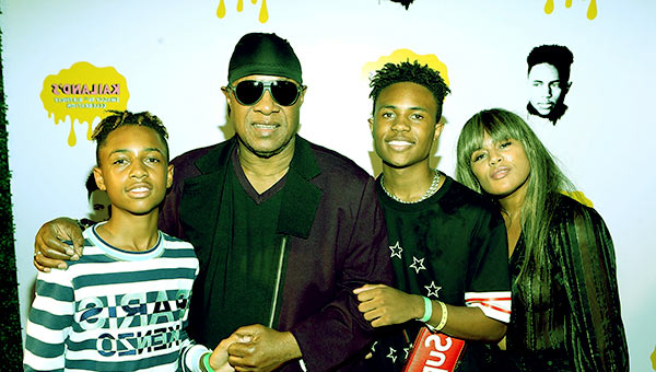 Image of Kai Millard Morris, Kailand Morris, Stevie Wonder and Mandla Kadjay Carl Stevland Morris