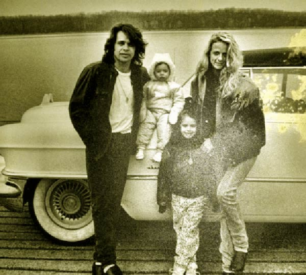 Image of Victoria Granucci and her husband John Mellencamp and with their kids