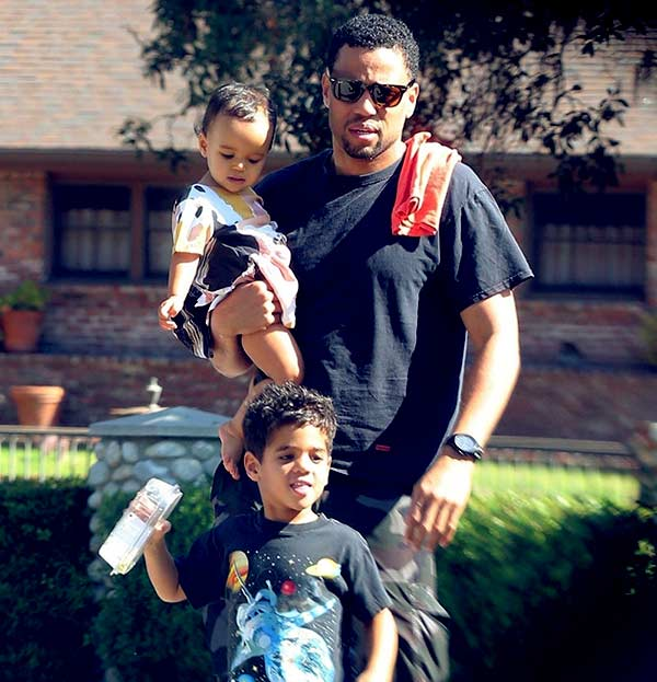 Image of Michael Ealy with his daughter and son Elijah Brown