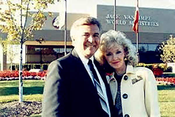 Image of Caption: Rexella and Jack Van Impe in front of their ministry